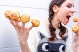 Woman with Donut Fingers Free Photo
