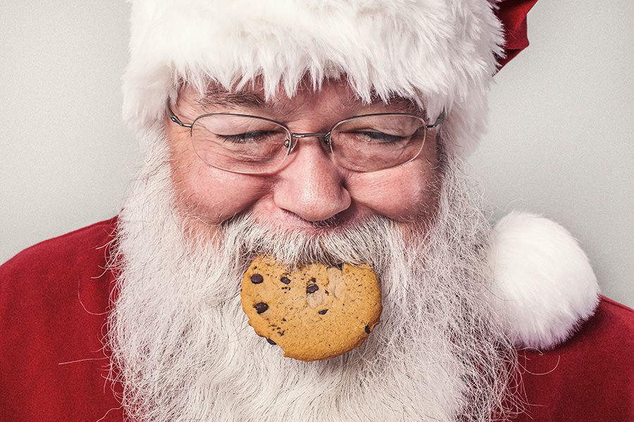 Santa Clause Eating Cookie Free Photo