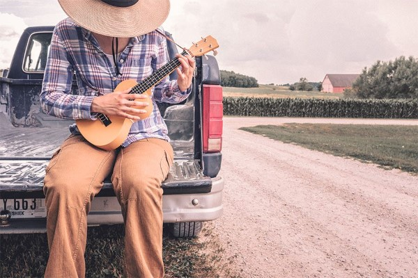 Farmer Playing Small Guitar Free Photo