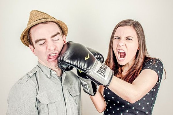 Woman Punching a Man Free Photo