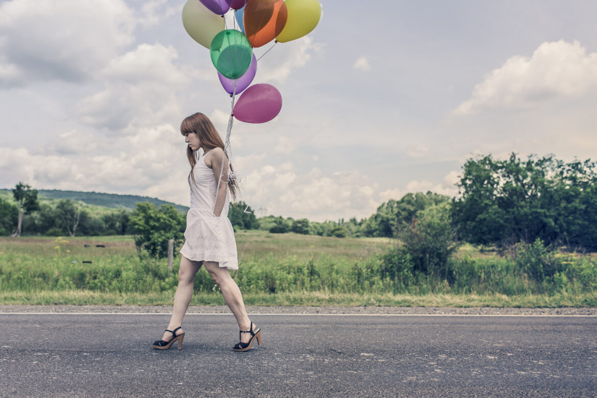Woman & Colorful Balloons Free Stock Photo