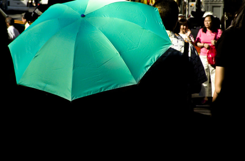 Woman With Green Umbrella Free Photo