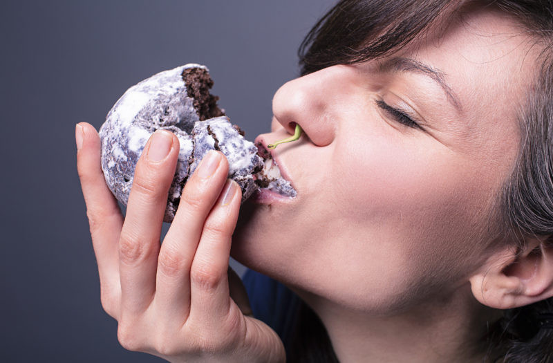 Woman & Donut Free Stock Photo