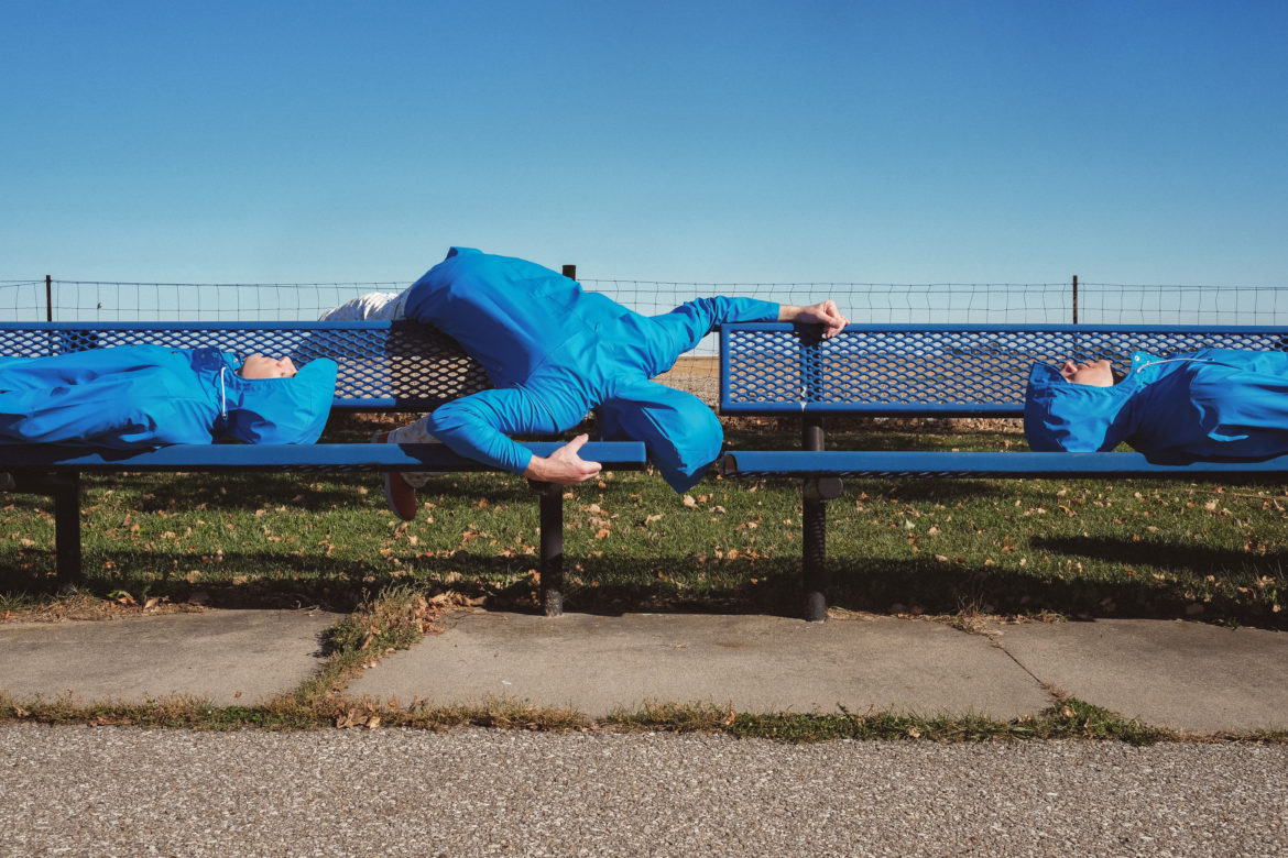Blue Man on Bench Free Stock Photo