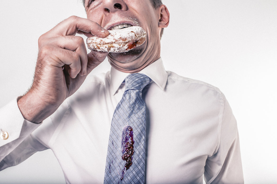 Man Eating Donut Free Photo