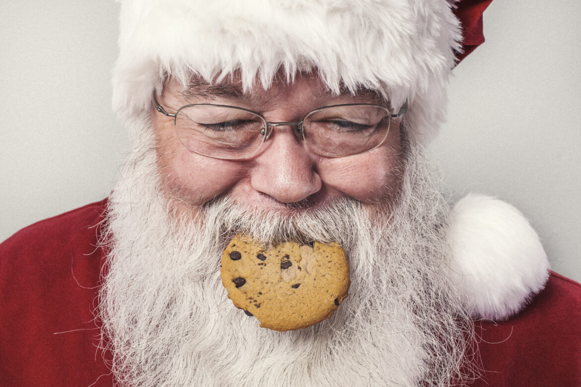Santa Clause Eating Cookie Free Stock Photo