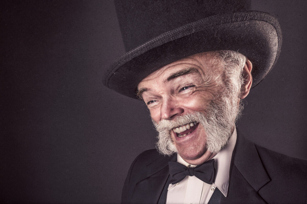 Smiling Man in Goofy Hat Free Stock Photo