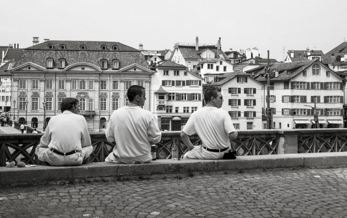 Boys Sitting on a Wall Free Stock Photo