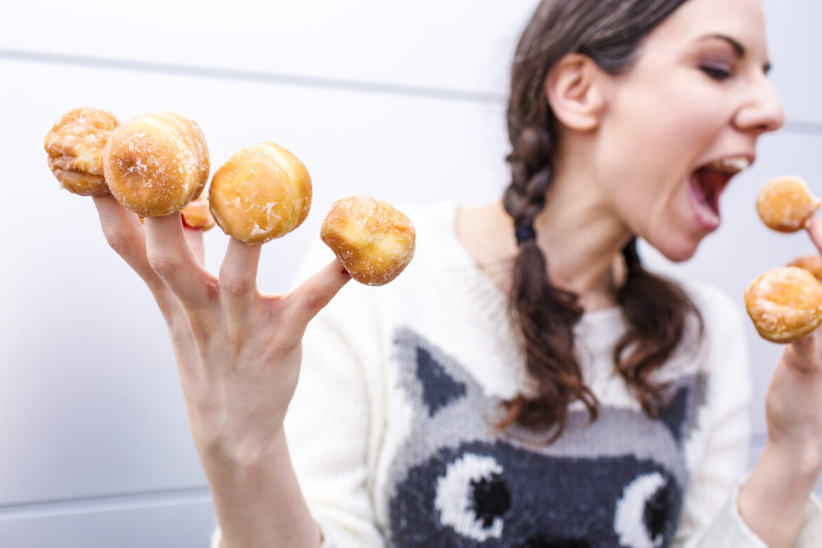 Woman with Donut Fingers Free Stock Photo