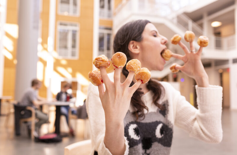 View Eating Donut Holes Free Stock Image